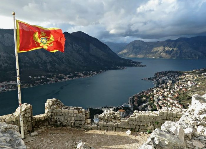 albanias flag from the top of kotor fortress kotor montenegro by anika mikkelson miss maps www missmaps com1.xlZY3